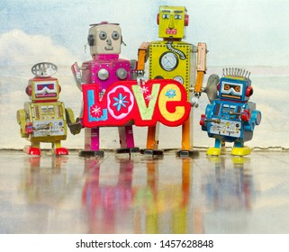 happy robot family with a bright color cloth love sign on a old wooden floor with reflection