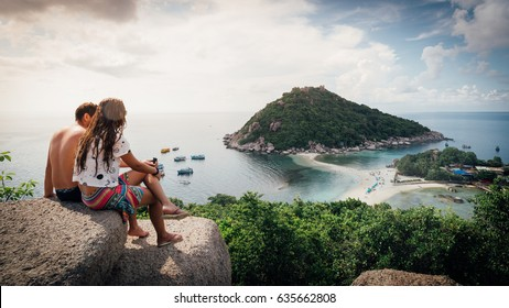 Happy Romantic Couple Enjoying at viewpoint on island,Travel Vacation Lifestyle summer Concept.Tropical paradise on the island of Koh nang yuan in Thailand,vintage tone