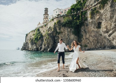 Happy romantic couple in Italy. Young wedding couple having fun Time in Italy.