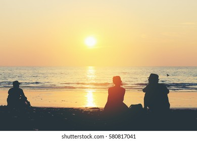 Happy Romantic couple  on the beach at colorful sunset on background