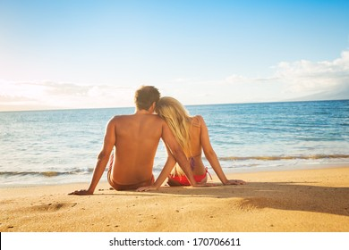 Happy Romantic Couple Watching the Sunset on Tropical Beach Vacation