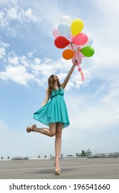 Happy romantic fashion girl with colorful balloons, outdoors.