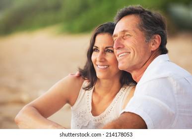 Happy Romantic Mature Couple Enjoying Sunset on the Beach