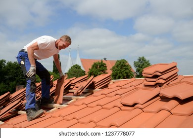 happy roofing craftsman at work in spring