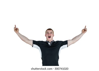 Happy rugby player gesturing victory on a white background