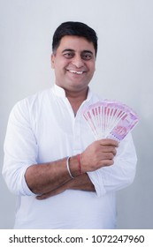 Happy Rural Man Showing 2000 Rupees Notes On White background Money Concep