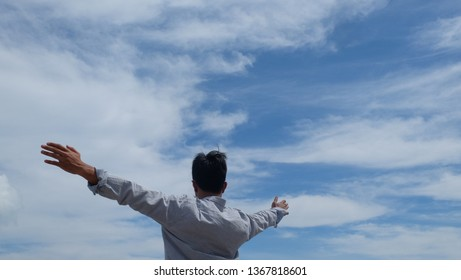 Happy Salaryman Enjoying life on background sky clouds view