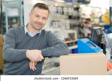 happy sales assistant in furniture store