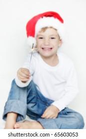 happy santa boy with sparkler over white