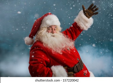 Happy Santa Claus laughing while standing outdoors at North Pole