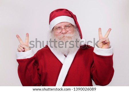 9ef4f048ff8a1 Happy Santa Claus showing a peace sign. Closeup portrait isolated on white  background. Christmas