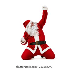 Happy Santa Claus sliding on the knees isolated on white background