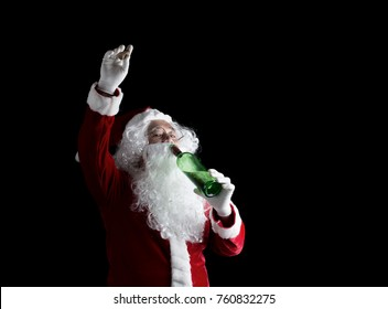 Happy Santa drinking alcohol in green bottle over on black background