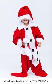 Happy santa helper trying on very large christmas costume - having fun