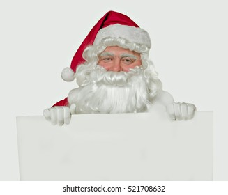 Happy Santa  holding white  blank isolated for text for your creativity.