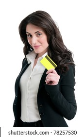 Happy satisfied business woman holding and showing her credit card isolated on white background
