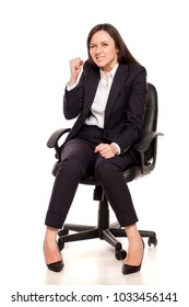 happy and satisfied businesswoman in armchair on white background
