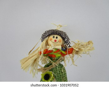 happy scarecrow figure with a red nose