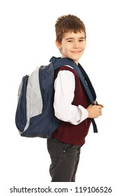 Happy school boy with back bag standing in profile and smiling to camera isolated on white background