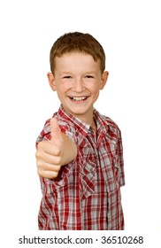 Happy school boy showing thumbs up isolated on white