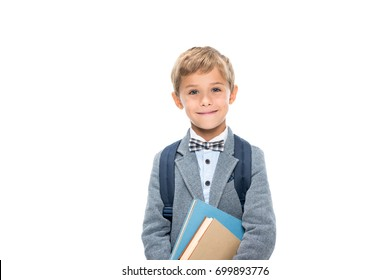 happy schoolboy with books and backpack isolated on white