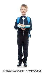 happy schoolboy with textbook and backpack on a white background in full length isolated