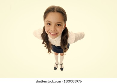 Happy schoolgirl with long hair isolated on white. Little girl smiling in school uniform, top view. Cute child with adorable smile. Beauty salon. Look great all year round.