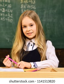 happy schoolgirl with smiling face in school. happy schoolgirl. happy schoolgirl at school lesson. happy schoolgirl is ready to study. smiling small girl.