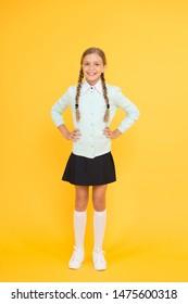 Happy schoolgirl. Schoolgirl happy smiling pupil long hair. Beginning of academic year. Educational activity. Homeschooling or visiting regular school. Efficiency of studying. Adorable schoolgirl.