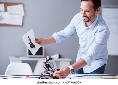 Happy scientist holding a prototype of his invention