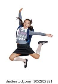 Happy screaming schoolgirl jumping high in a white studio
