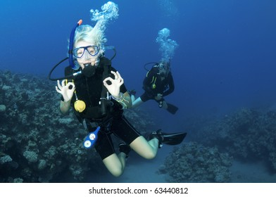 happy scuba divers in the red sea