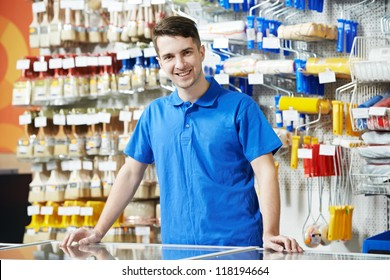 Happy seller assistant man in DIY hardware or home improvement store