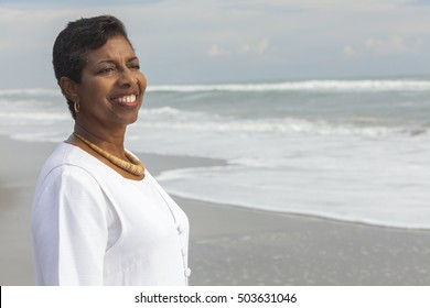 Happy senior African American woman smiling on a beach