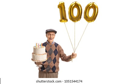 Happy senior with a birthday cake and a number hundred balloon isolated on white background