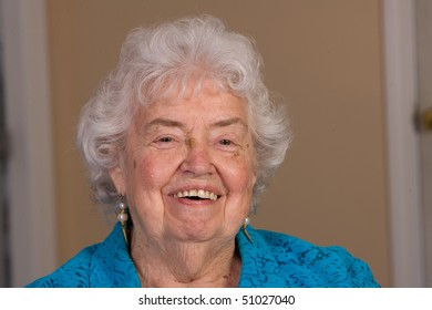 Happy senior citizen woman laughing in this closeup.