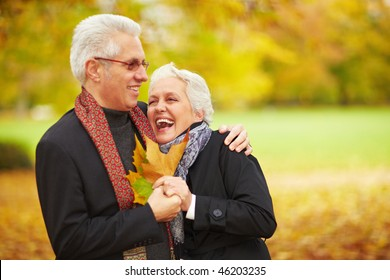 Happy senior couple in an autumn forest