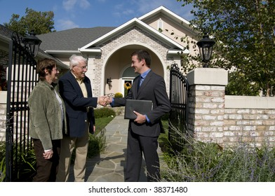 happy senior couple buying a new home from a real estate agent