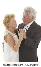 Happy senior couple dancing Isolated on white background.