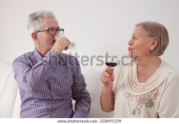 Surprising Happy Senior Couple Drinking Red Wine Royalty Free Stock Image Inzonedesignstudio Interior Chair Design Inzonedesignstudiocom