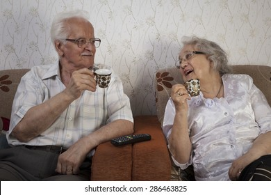 Happy senior couple drinking their morning coffee