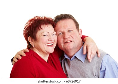 Happy senior couple embracing each other face to face
