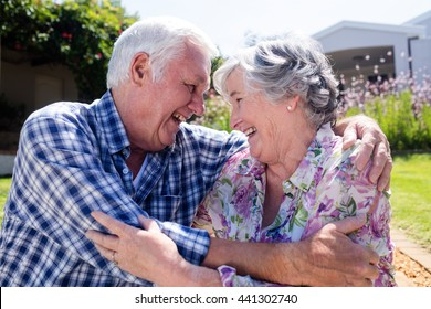 Happy senior couple embracing in the garden