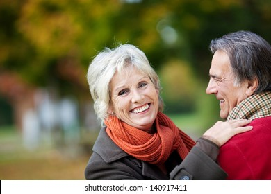 A happy senior couple enjoying a moment of love in the forest