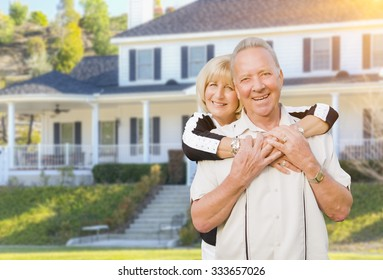 Happy Senior Couple in the Front Yard of Their House.