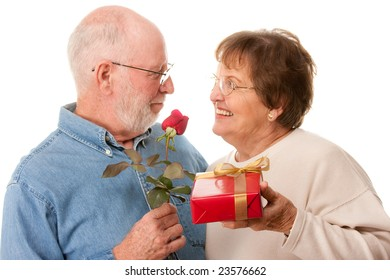 Happy Senior Couple with Gift and Red Rose Isolated on a White Background.