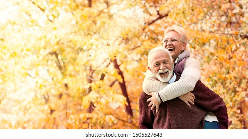 Happy senior couple with healthy white smile
