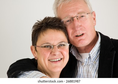 Happy senior couple holding each other