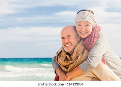 happy senior couple hugging enjoying retirement