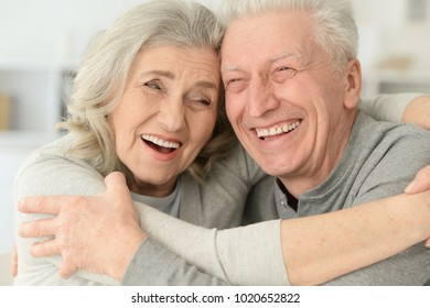 happy senior couple laughing  at home